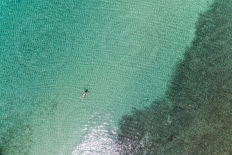 Aerial view of a girl swimming in the sea photo