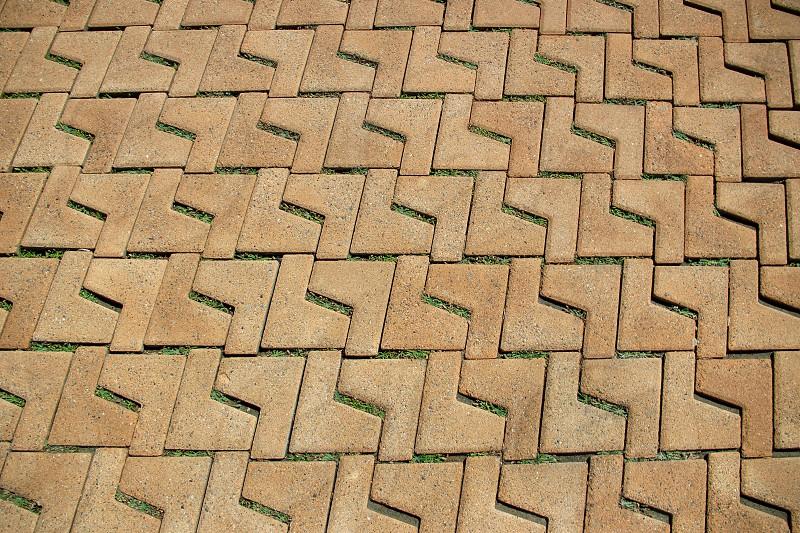 brown L shaped brick surface photo