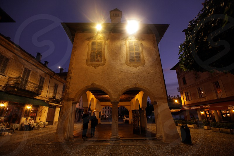 The Square in the Fishingvillage of Orta on the Lake Orta in the Lombardia  in north Italy.  photo