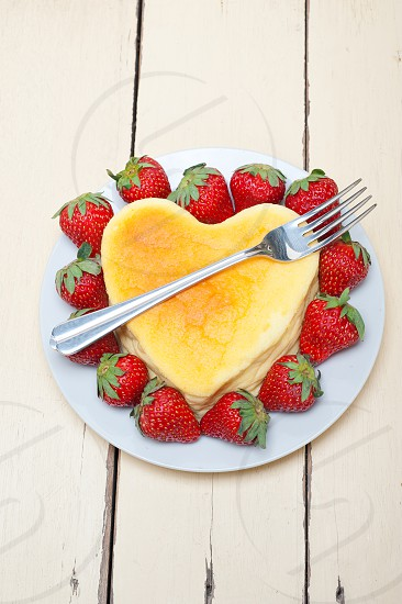 heart shaped cheesecake with strawberryes ideal cake for valentine day photo