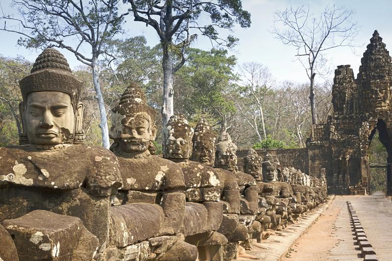 Angkor Wat Temple Cambodia - March 2018: Stone Asuras hold the nāga Vasuki on a bridge leading into the 12th century city of Angkor Thom.  photo