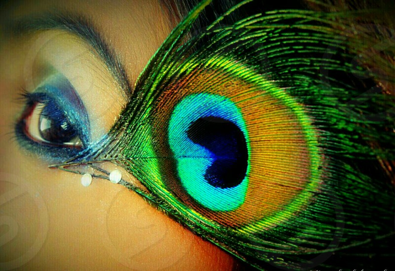 beautiful eyes with peacock feather photo