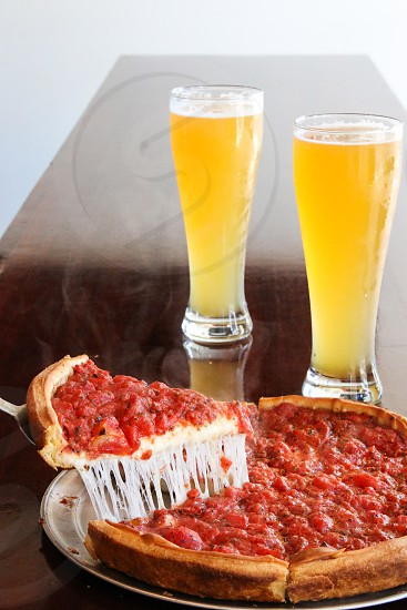 Chicago pizza with cheese stretch photo