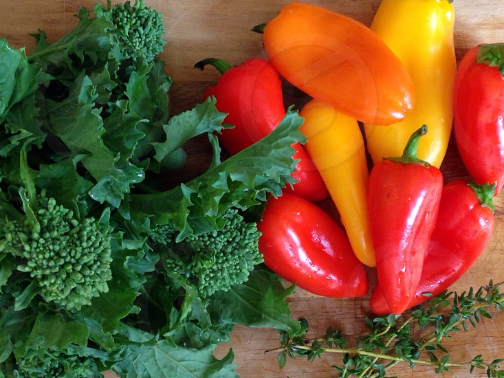 Broccolini thyme and red and yellow peppers photo