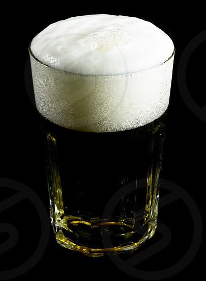 glass of lager  beer over black background photo