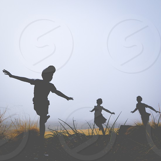 Foggy morning with children statues photo