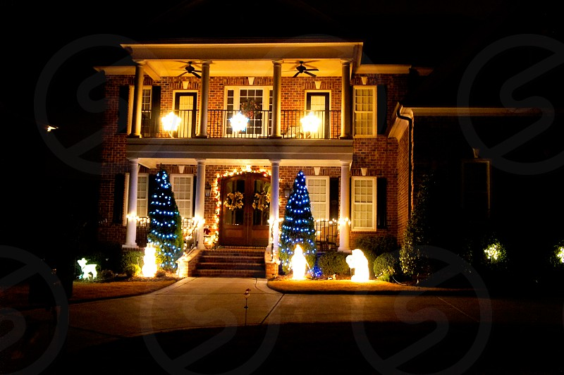 Night exterior image of a house decorated for Christmas photo