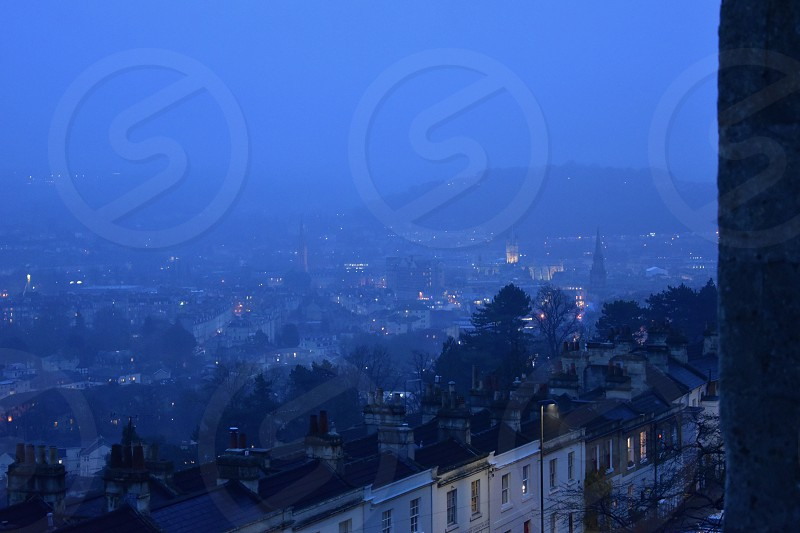 View over rooftops towards city in twilight. photo