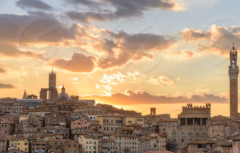 View of the city of Siena at sunset photo