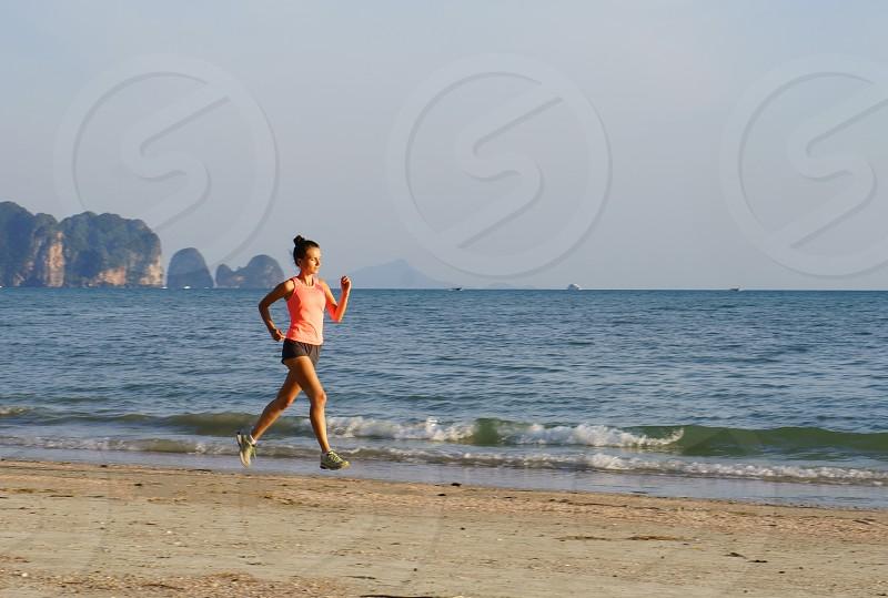 girl running near seashore photo