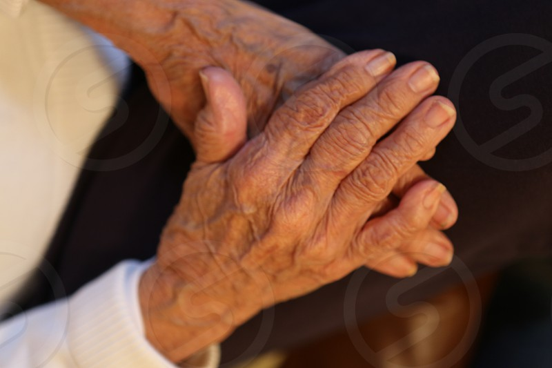 Old hands wrinkles hands joint pain. photo