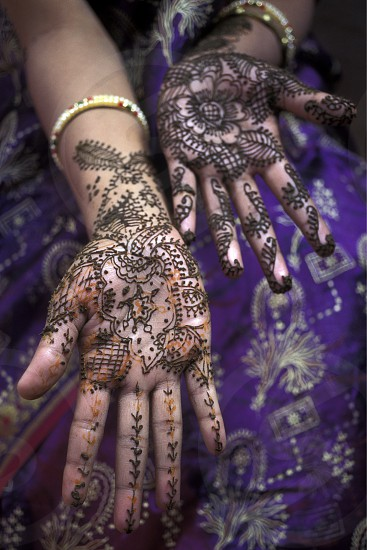 a women is making henna in the town of Jaisalmer in the province of Rajasthan in India. photo