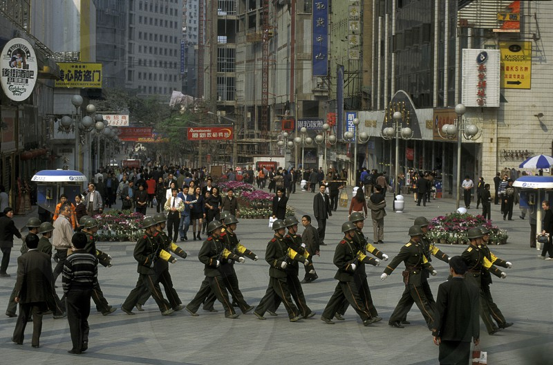 The army and people on the streets of Chongqing in the province of Sichuan in china in east asia.  photo