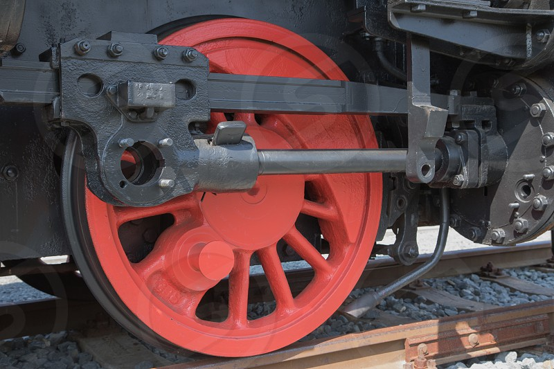 Closeup of red color wheel of historical steam locomotive. photo