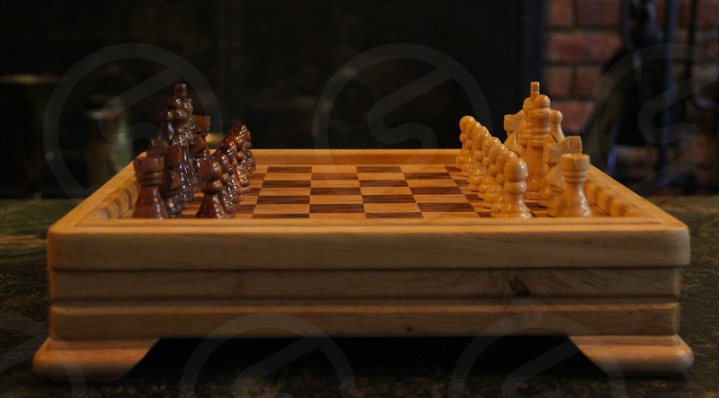 brown wooden chess board photo