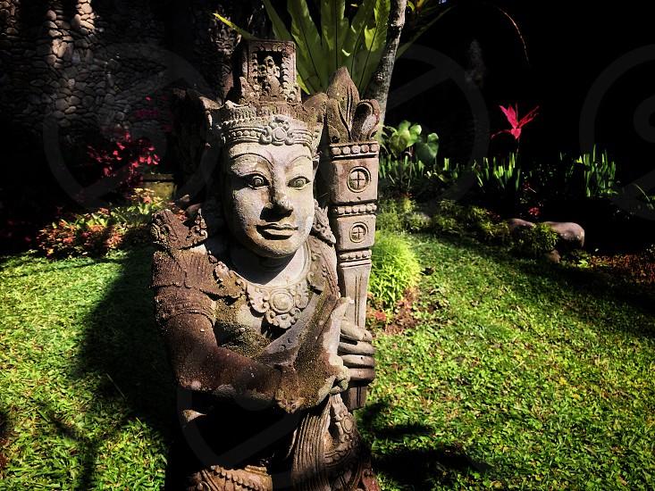 statue garden morning Bali stone sculpture photo