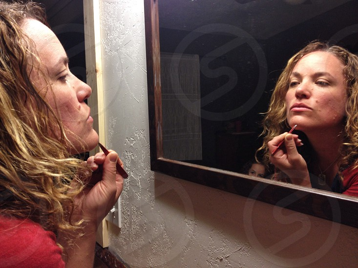 woman in front of mirror photo