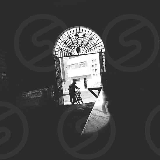 man holding bike silhouette  photo