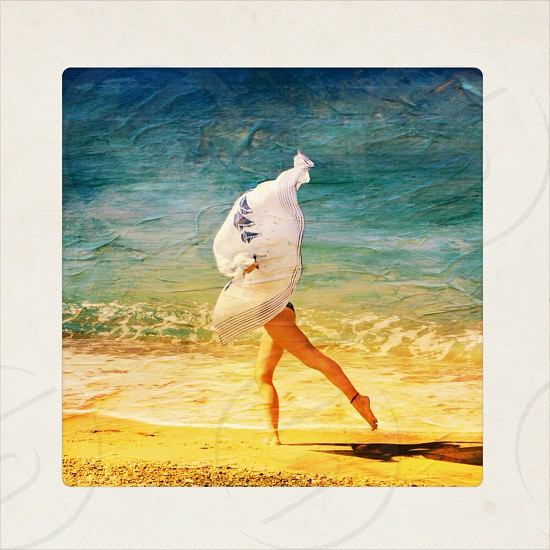 painting of woman running on the beach photo