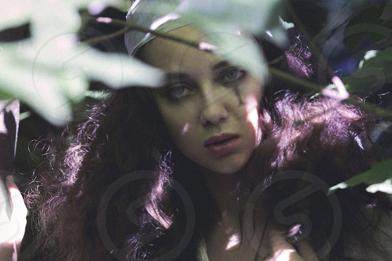 fashion beauty model forest nature leaves big hair natural makeup hippie bohemian photo