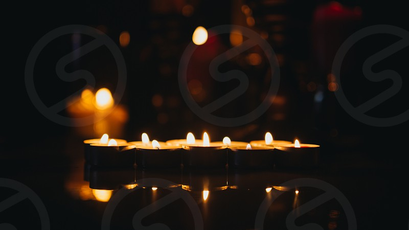 candles lighted placed on table photo