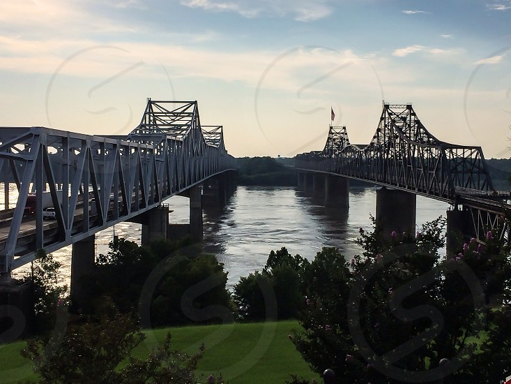 Car and train bridges over the Mississippi River connecting Mississippi and Louisiana in Vicksburg MS.  photo