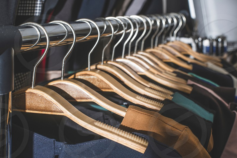Clothes on hangers in shop. Close up photo
