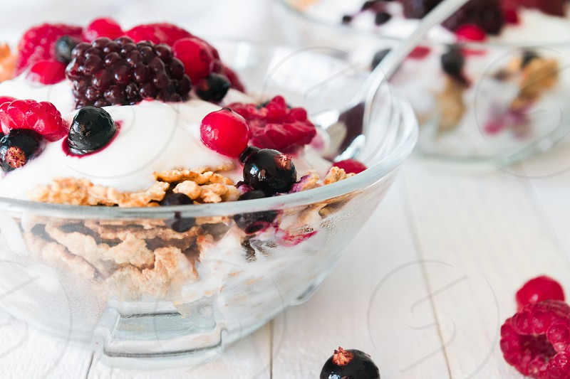 Granola with yogurt strawberries blackberries and blueberries photo