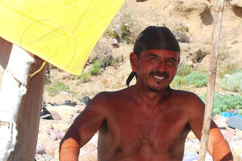 portrait man seaside smiling man beach summer photo