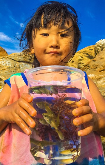 girl holding fish bowl photo