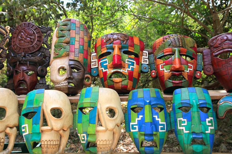Colorful Mayan handcraft masks of indian culture in Jungle of Mexico photo