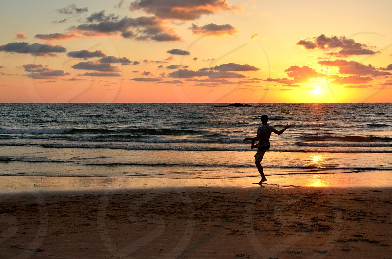 Sunset frisbee Atlit Israel photo