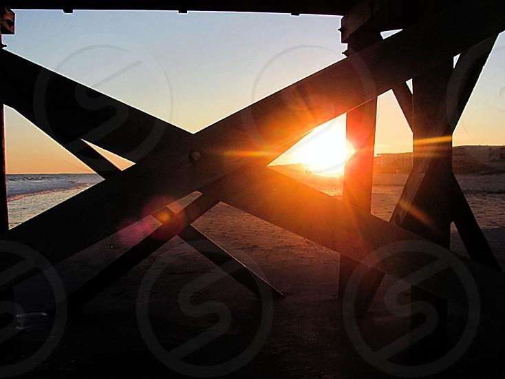 Sun through pier  photo