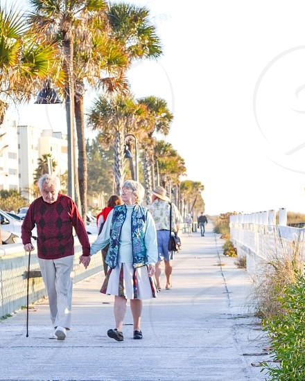 couple on a beach walk photo