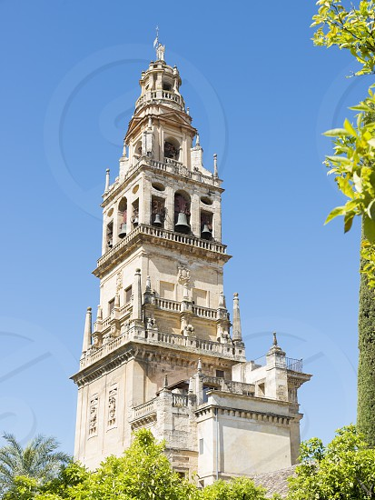Bell tower of La Mezquita in Cordoba in the southern Spanish province of Andalusia formerly a Roman city and an Islamic cultural center in the Middle Ages. photo