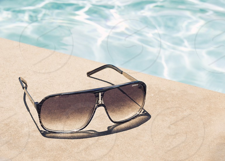 black and silver framed sunglasses photo