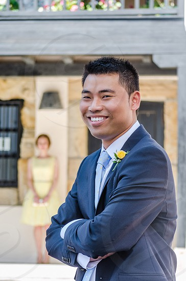 man with black short hair in black formal suit smiling photo