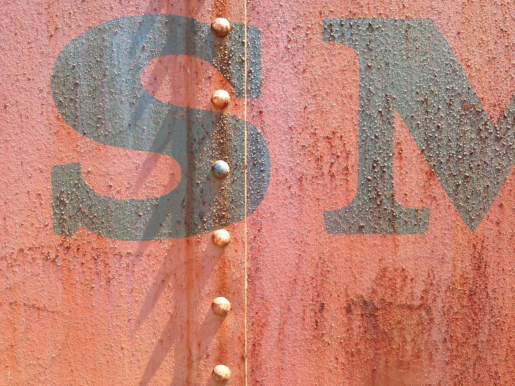 Train car caboose rusty red rivet smith travel trip metal photo