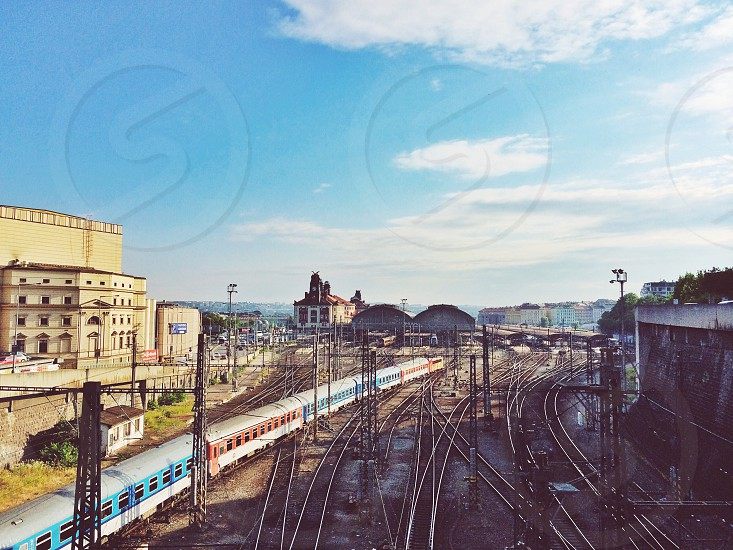 gray railroad near train photo