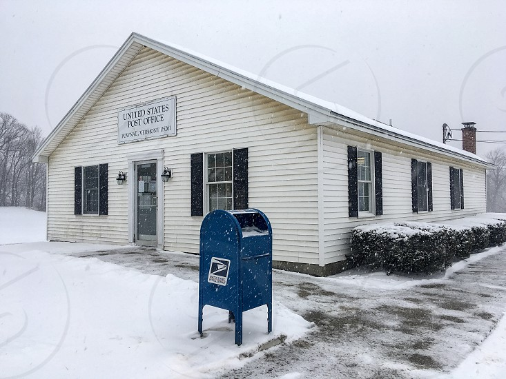 Rural post office during a snowstorm  photo