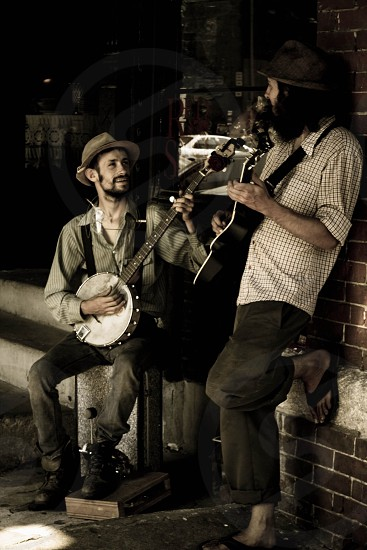 2 man playing instrument photo