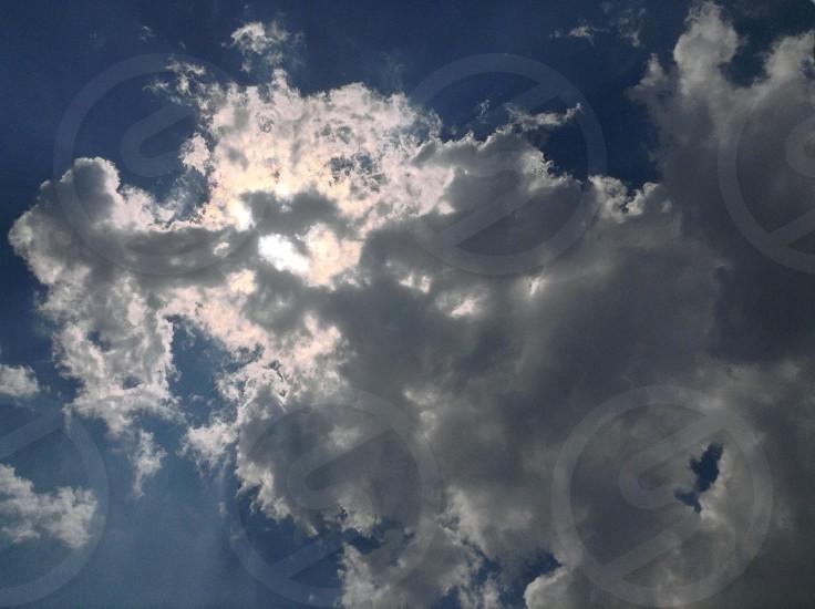 Clouds cloud skies sunlight sun photo