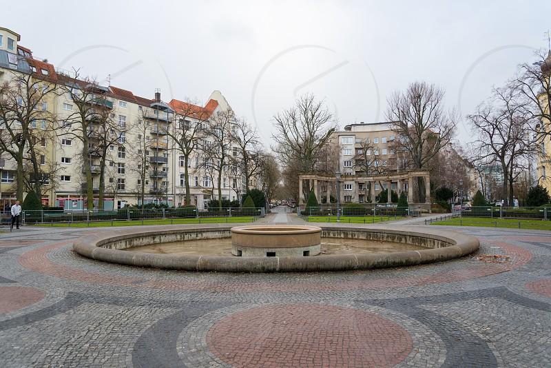 Outdoor scene of Viktoria-Luise-Platz to Motzstraße along with weird building windows inside Schoneberg Neighborhood in Berlin Germany photo