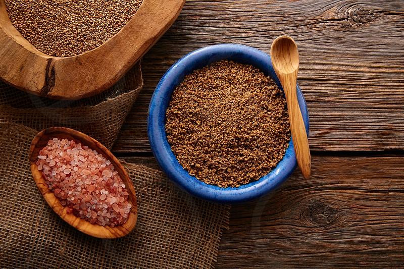 Sesame seeds gomasio seasoning ingredients with Himalayas salt photo