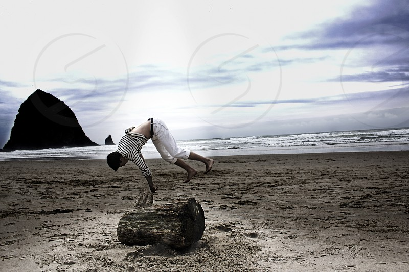 beach natural light ambient log young man 2012 sand lifestyle motion action acrobatic outdoor summer photo