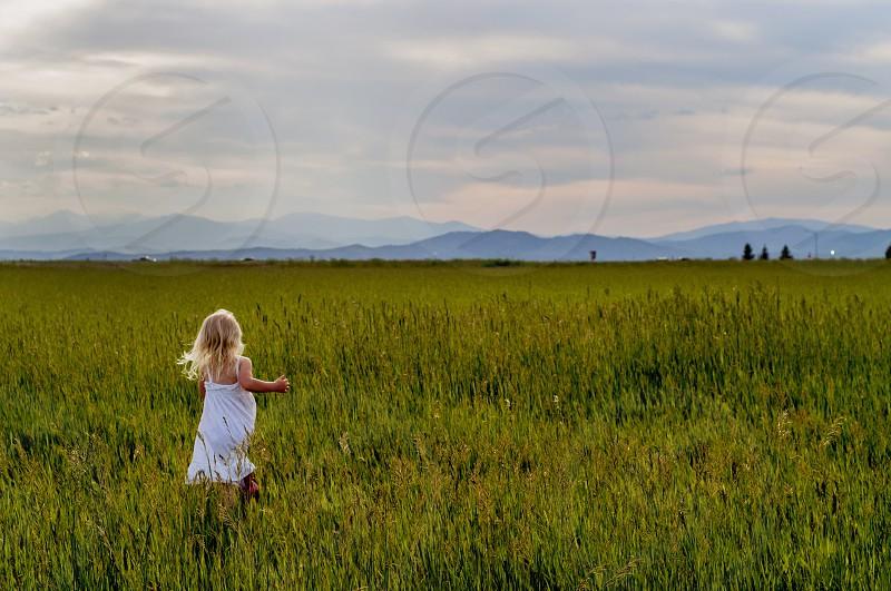 Mountains Rockiesfieldyoung girlrunningsummer Colorado free explore white dress photo
