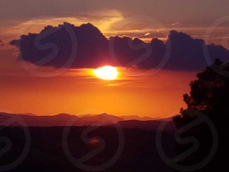 sunset on the hills photo