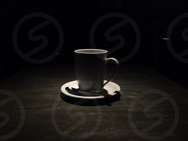 grey mug on white saucer  photo