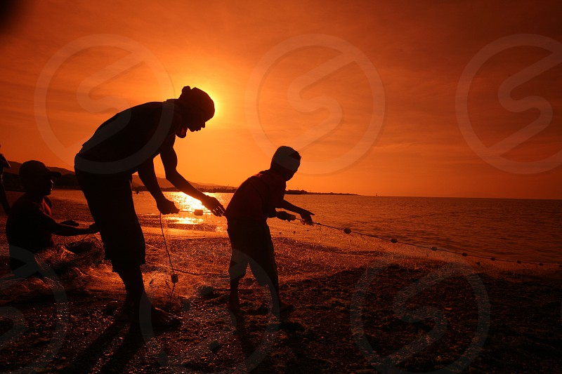 fishermen at the coast and beach at the city of Dili in the south of East Timor in southeastasia.
