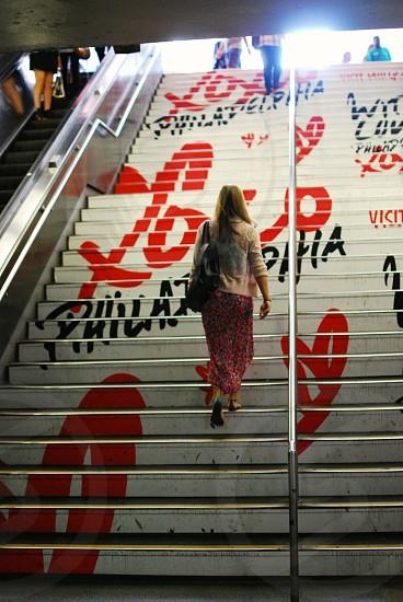 Manhattan Visit Philly woman stairs Penn Station New York City walking  photo